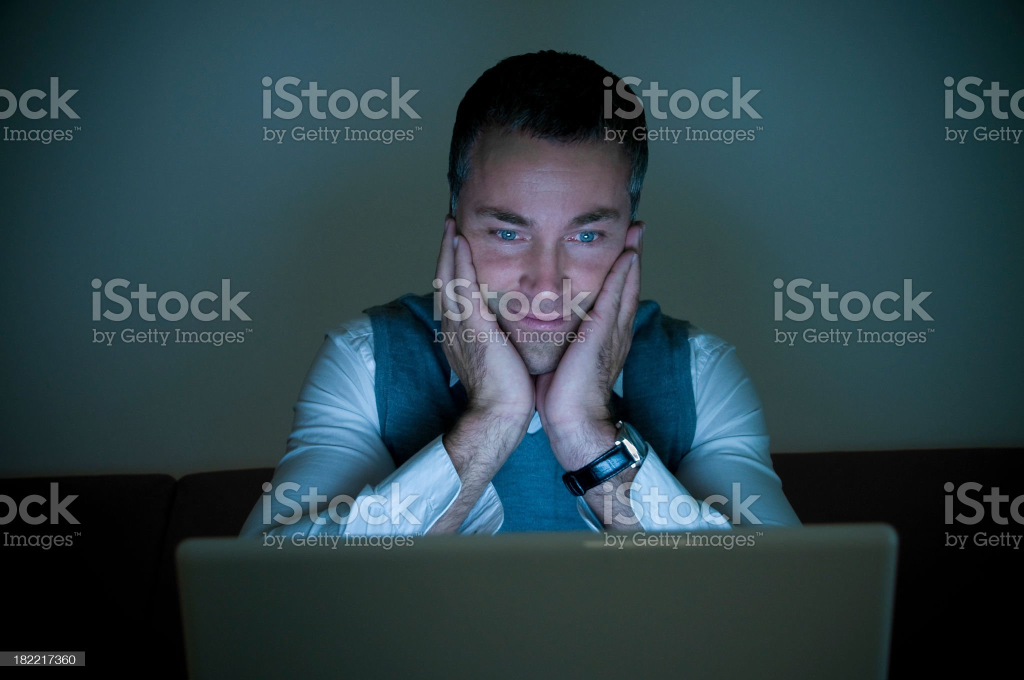 businessman smiling at computer royalty-free stock photo