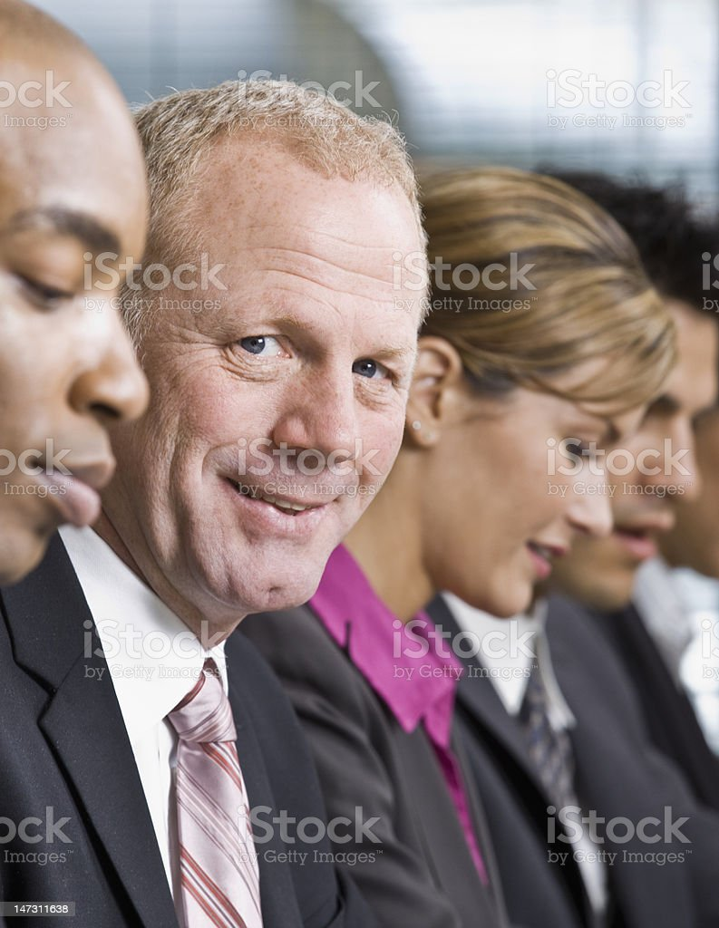 Businessman Smiling During Meeting royalty-free stock photo