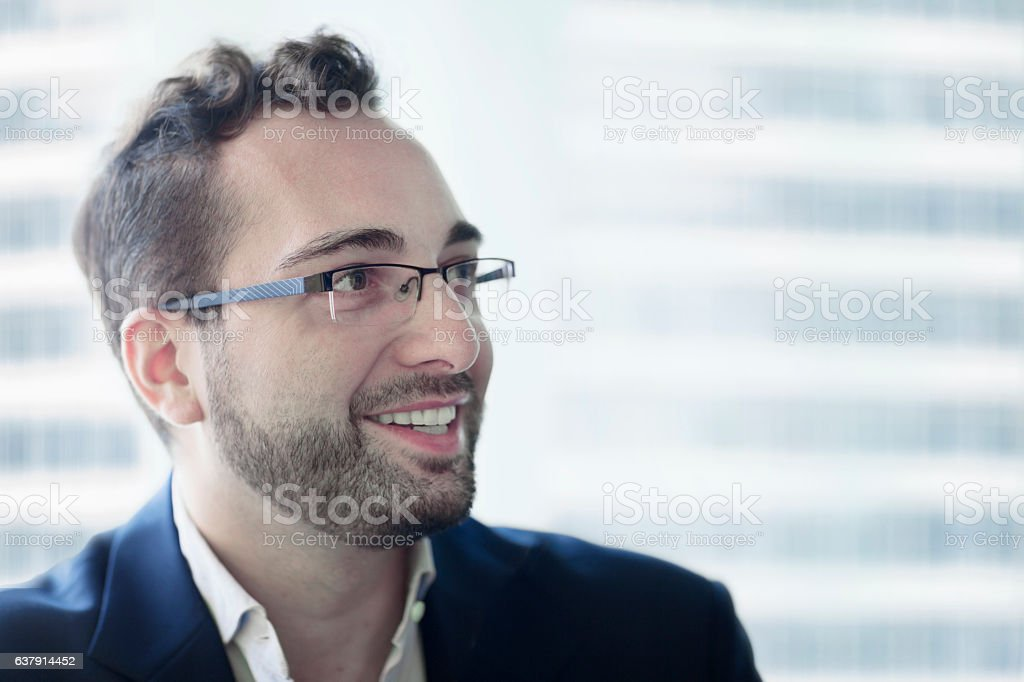 Businessman smiling in business office environment stock photo