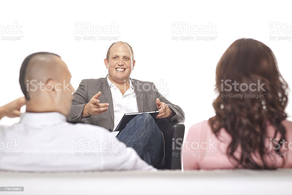 Businessman Smiling In Front Of Two Colleague royalty-free stock photo