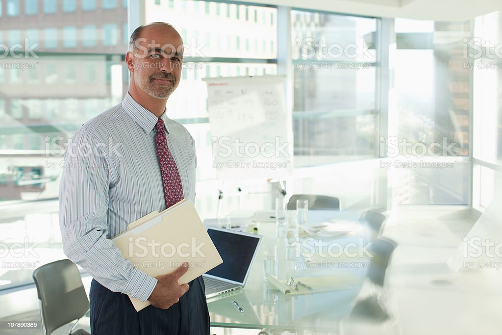 Businessman smiling in office stock photo