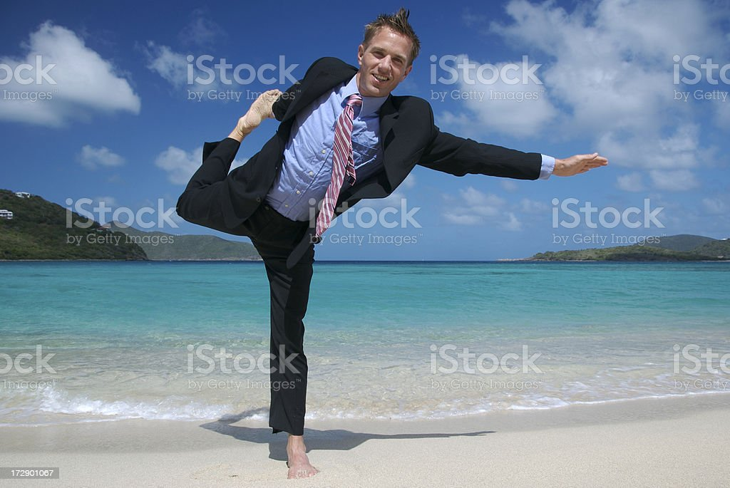 Businessman Smiling Stretch in Dark Suit on Tropical Beach royalty-free stock photo