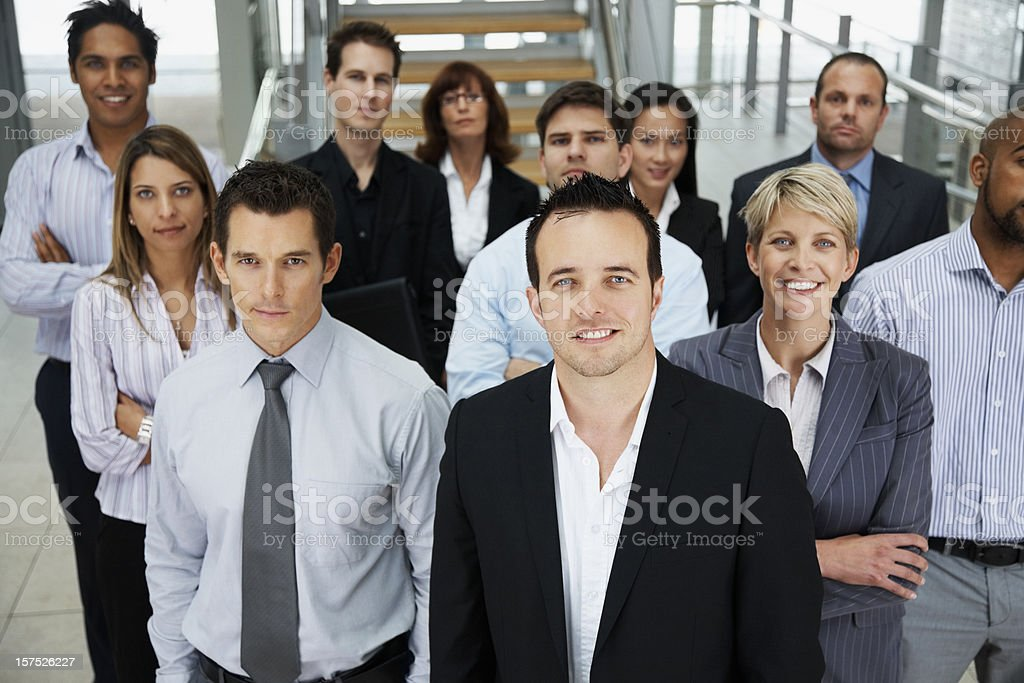 Businessman smiling with colleagues at the back royalty-free stock photo