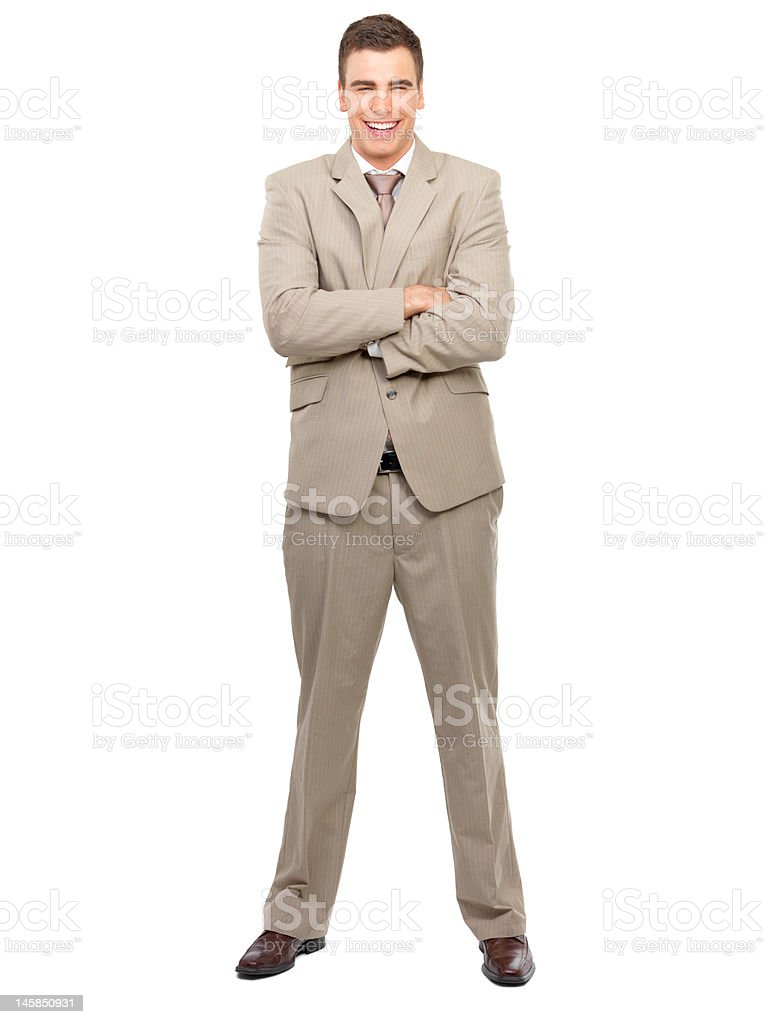 Businessman smiling with his arms crossed royalty-free stock photo