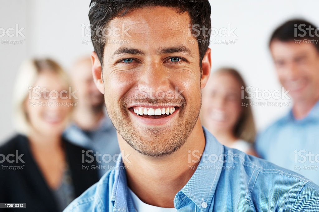 Businessman smiling with his business colleague in background stock photo