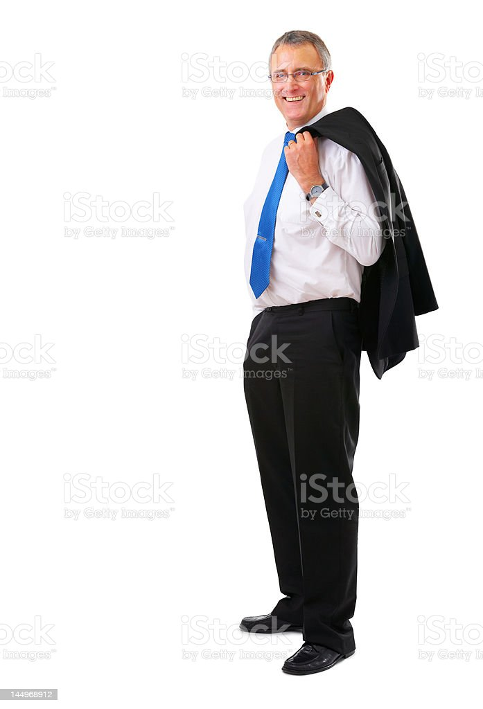 Businessman smiling with his jacket over shoulder royalty-free stock photo