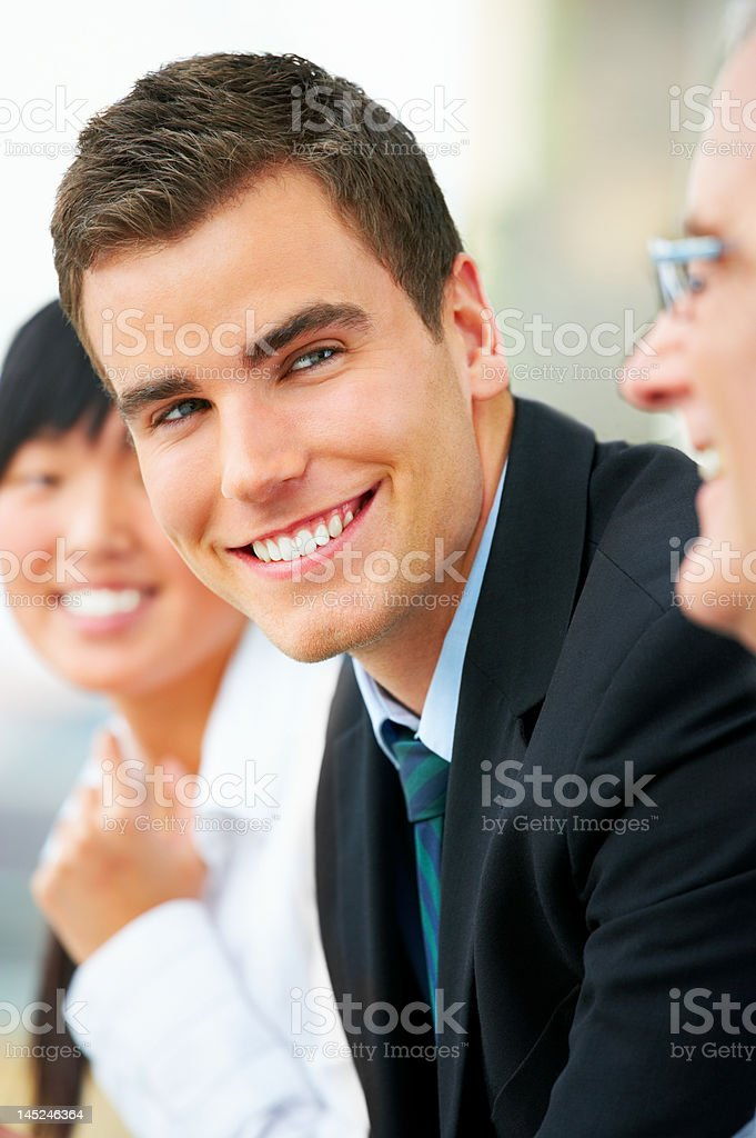 Businessman smiling with his team royalty-free stock photo