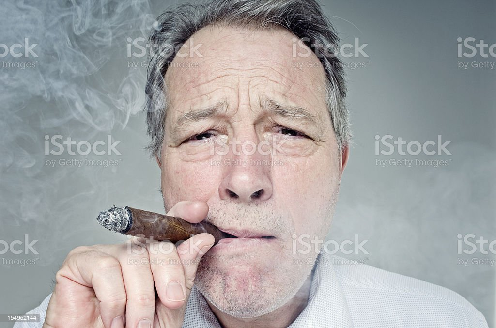Businessman Smoking a Cigar royalty-free stock photo