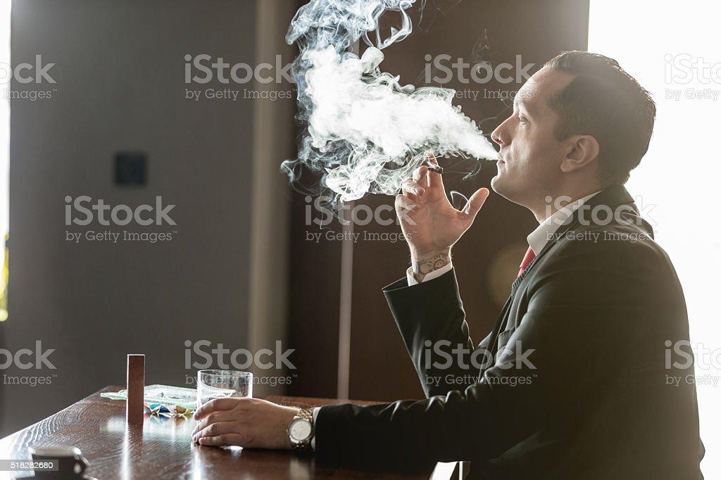 Businessman smoking a cigar stock photo