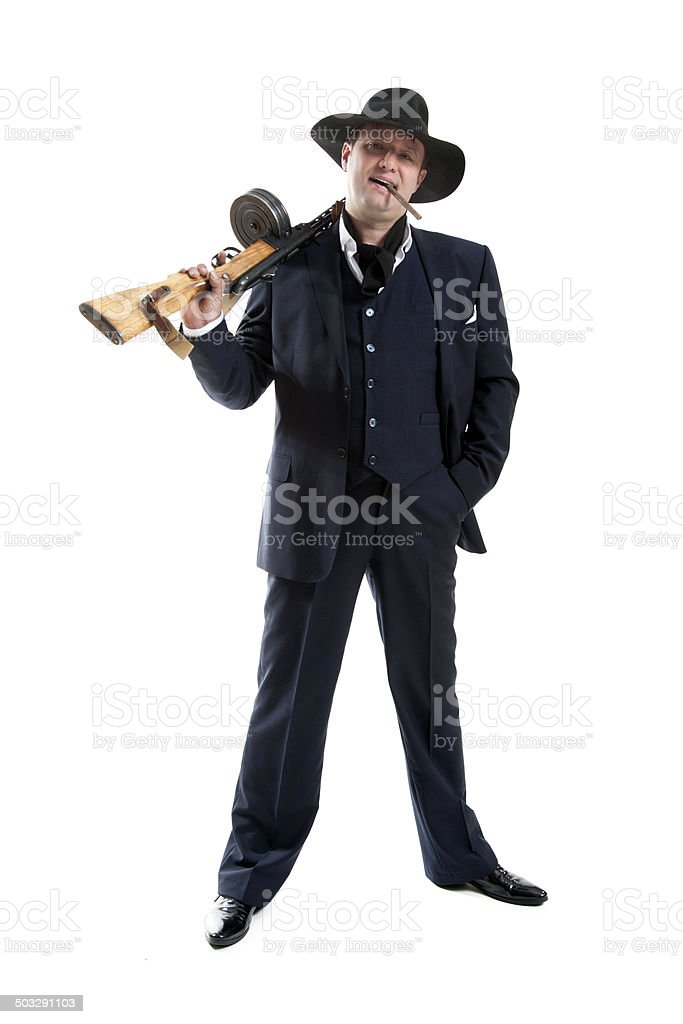 Businessman smoking a cigar with a gun stock photo