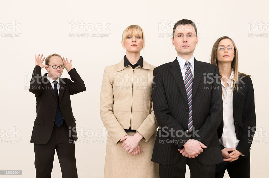 businessman sneering at serious business team royalty-free stock photo