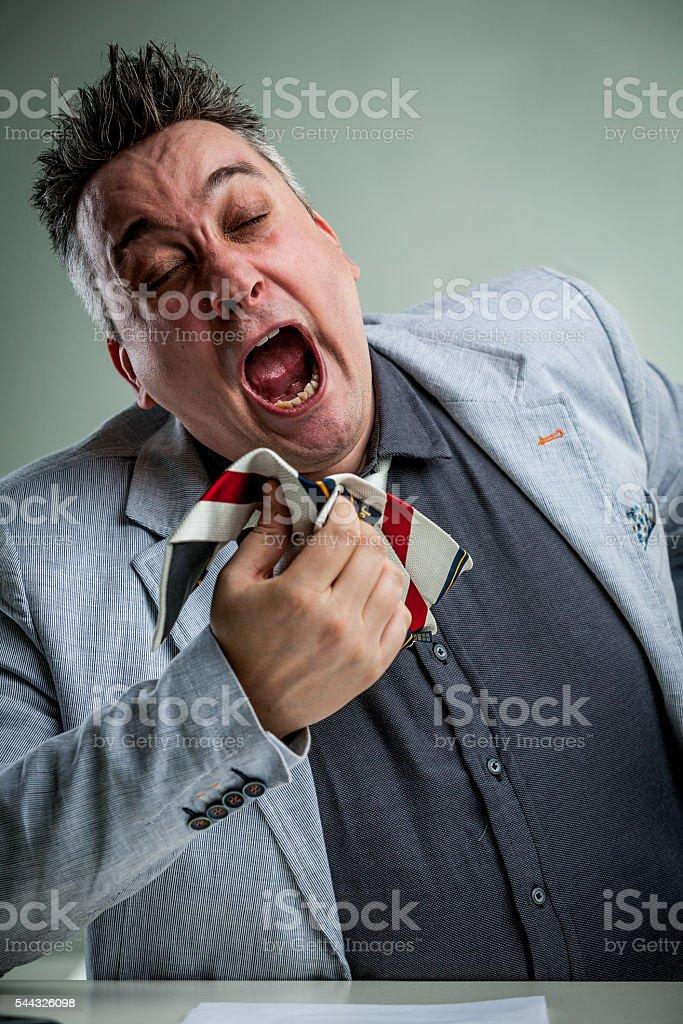 businessman sneezing on his necktie stock photo