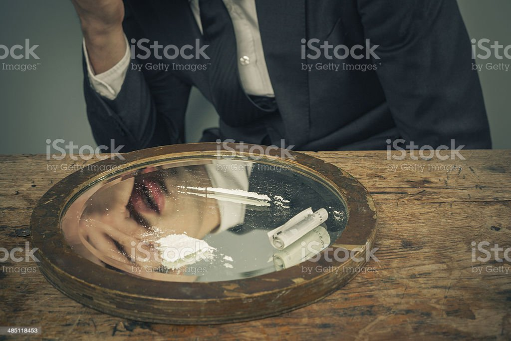 Businessman snorting cocaine royalty-free stock photo