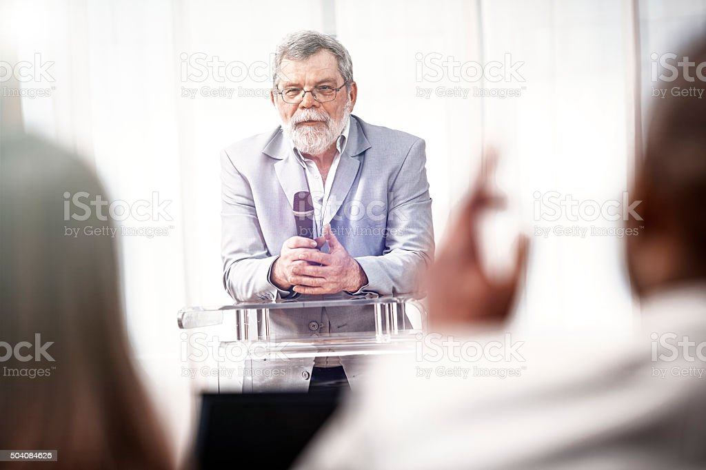 businessman speaking at a business conference stock photo