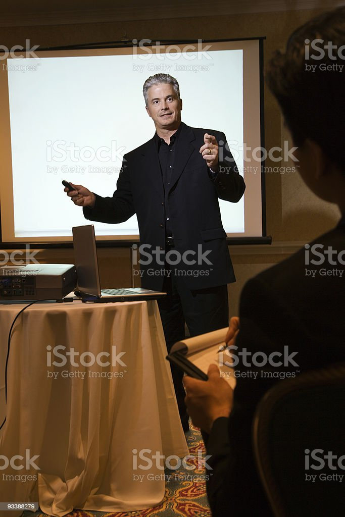Businessman speaking in front of screen. royalty-free stock photo