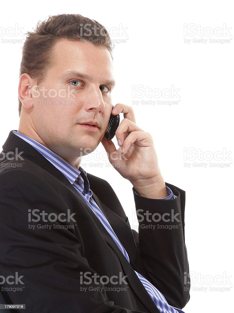 businessman speaking on his mobile isolated royalty-free stock photo