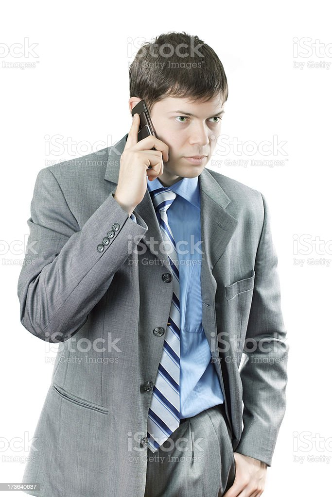 Businessman speaking over mobile phone stock photo