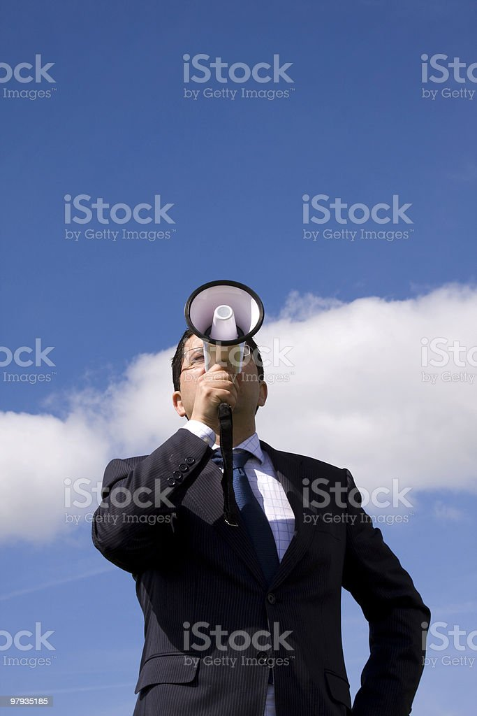 Businessman speaking with a megaphone royalty-free stock photo