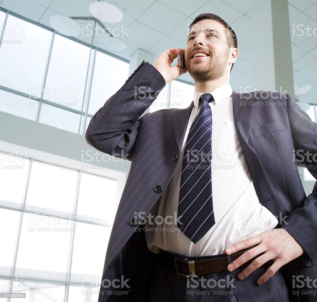 Businessman speaks by phone royalty-free stock photo