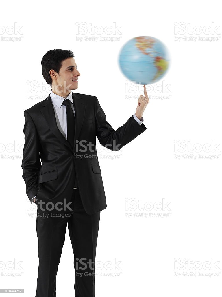 Businessman spinning a globe royalty-free stock photo
