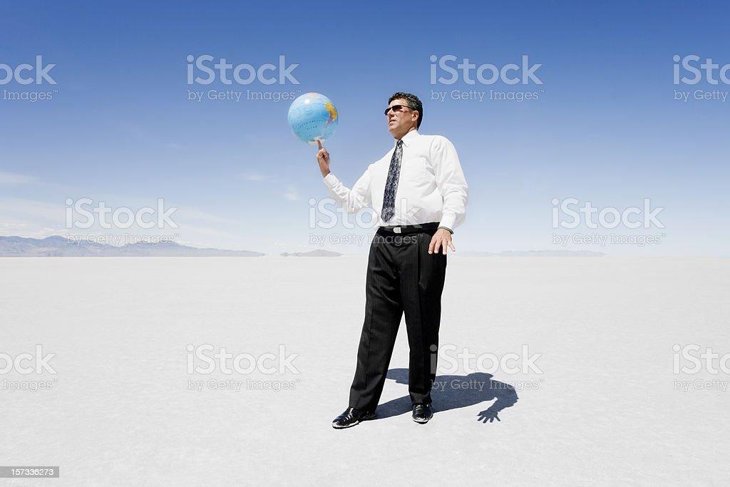 Businessman Spinning Globe stock photo