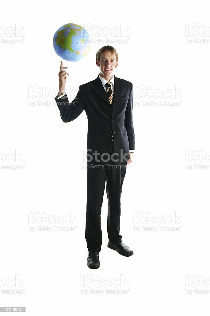 Businessman spinning the world stock photo