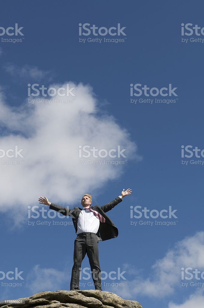 Businessman Spreads His Arms Across the Sky royalty-free stock photo