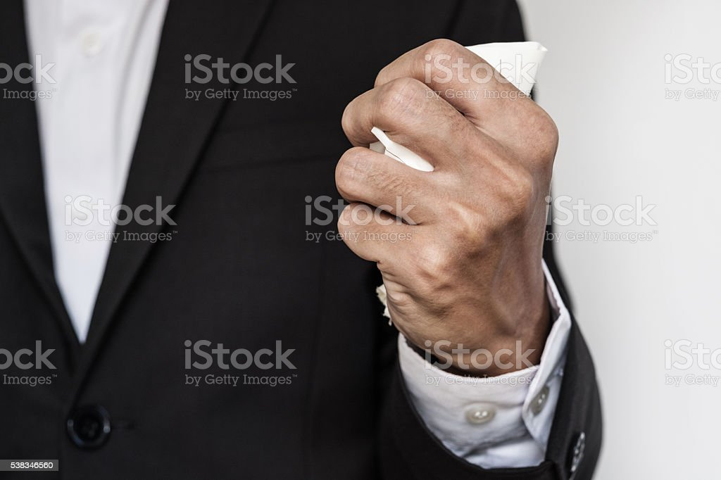 Businessman squeeze paper, hand close up stock photo