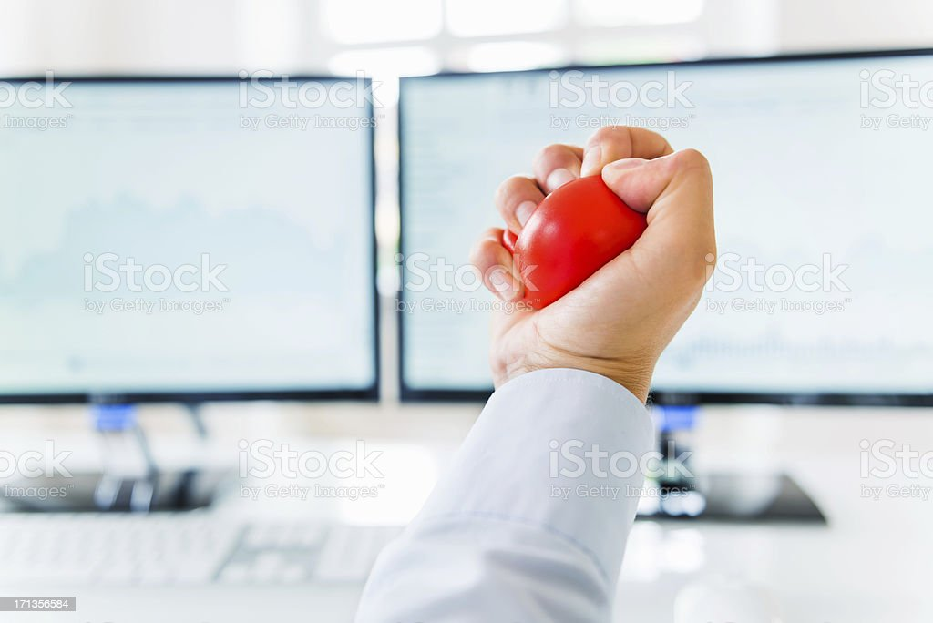 Businessman Squeezing Stress Ball stock photo