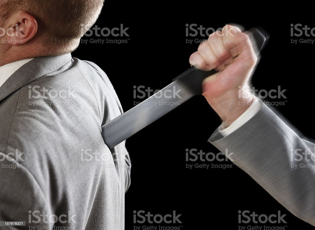 Businessman stabbed in the back stock photo