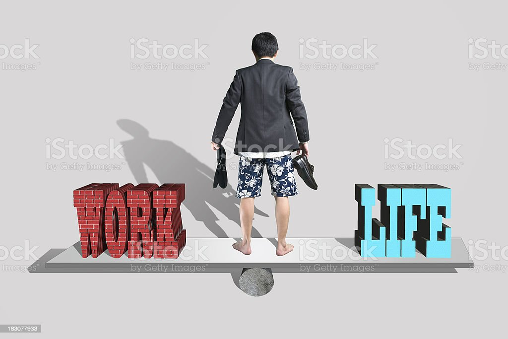 Businessman stand on seesaw with shoes and socks in hand stock photo