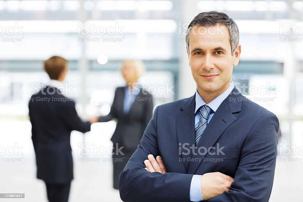 Businessman Standing Arms Crossed royalty-free stock photo