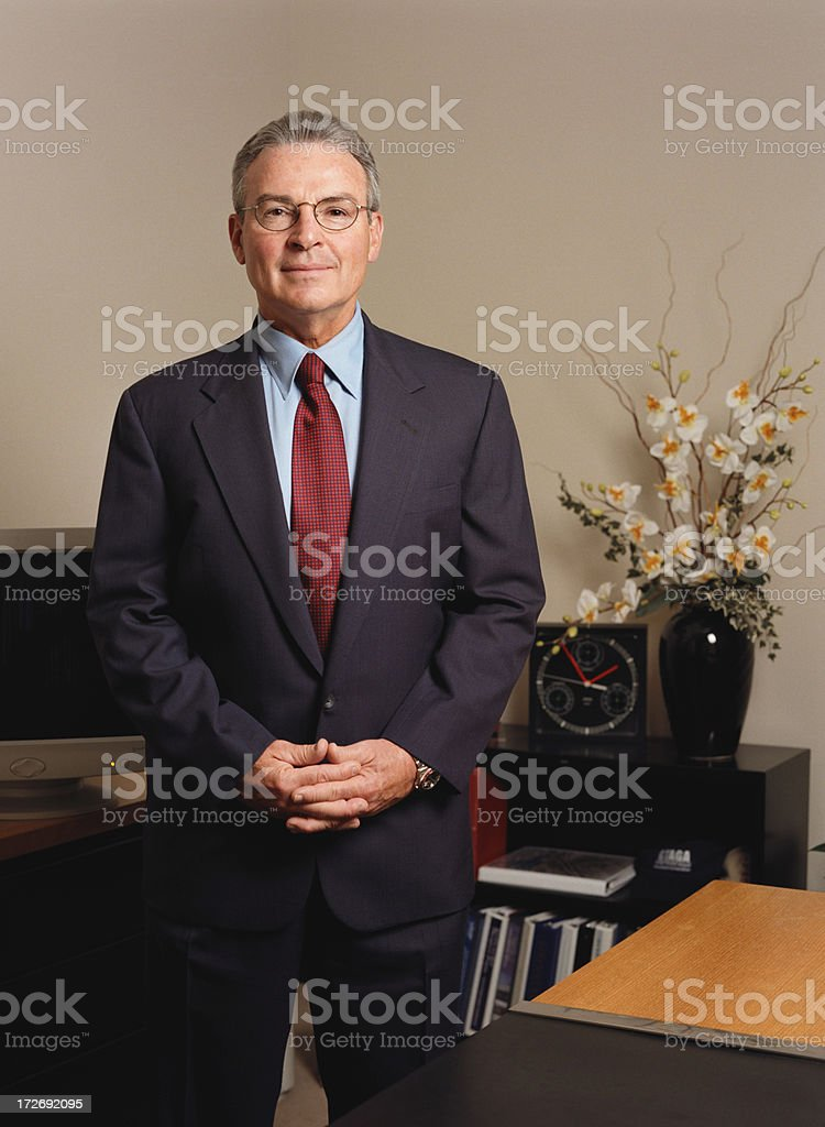 Businessman Standing by Desk royalty-free stock photo