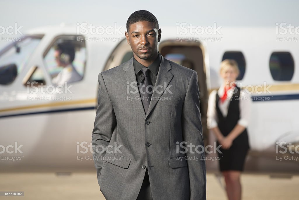Businessman Standing in front of Corporate jet royalty-free stock photo