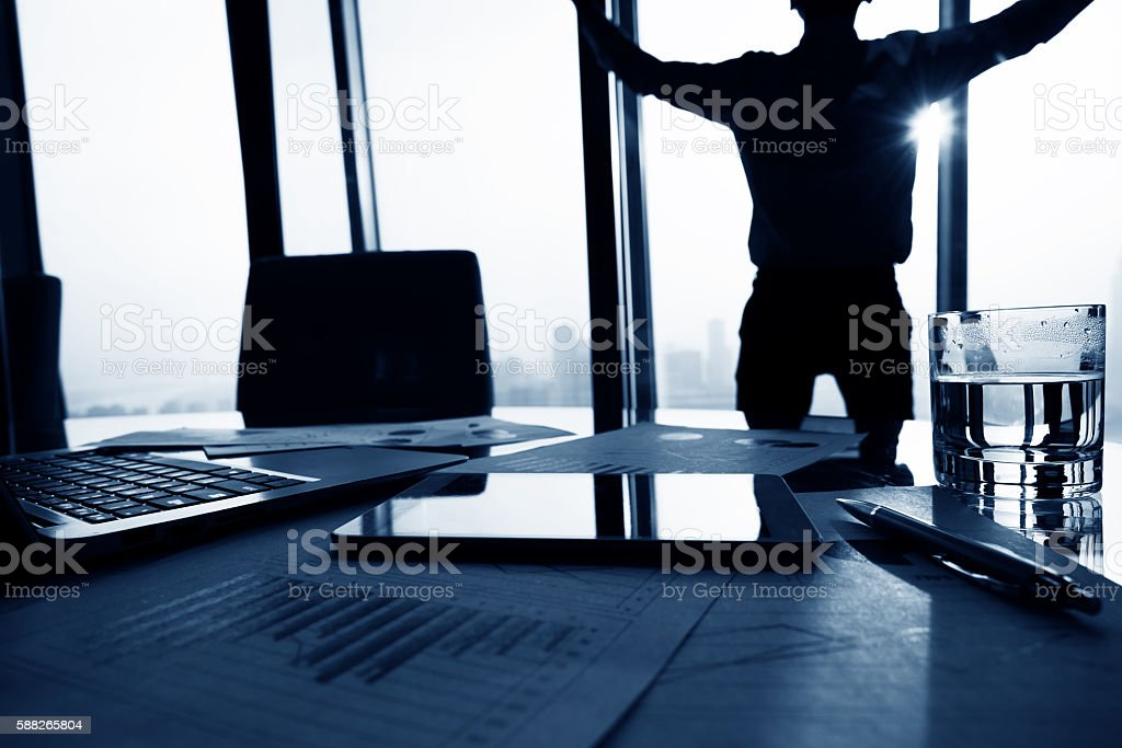 Businessman standing in front of window stock photo
