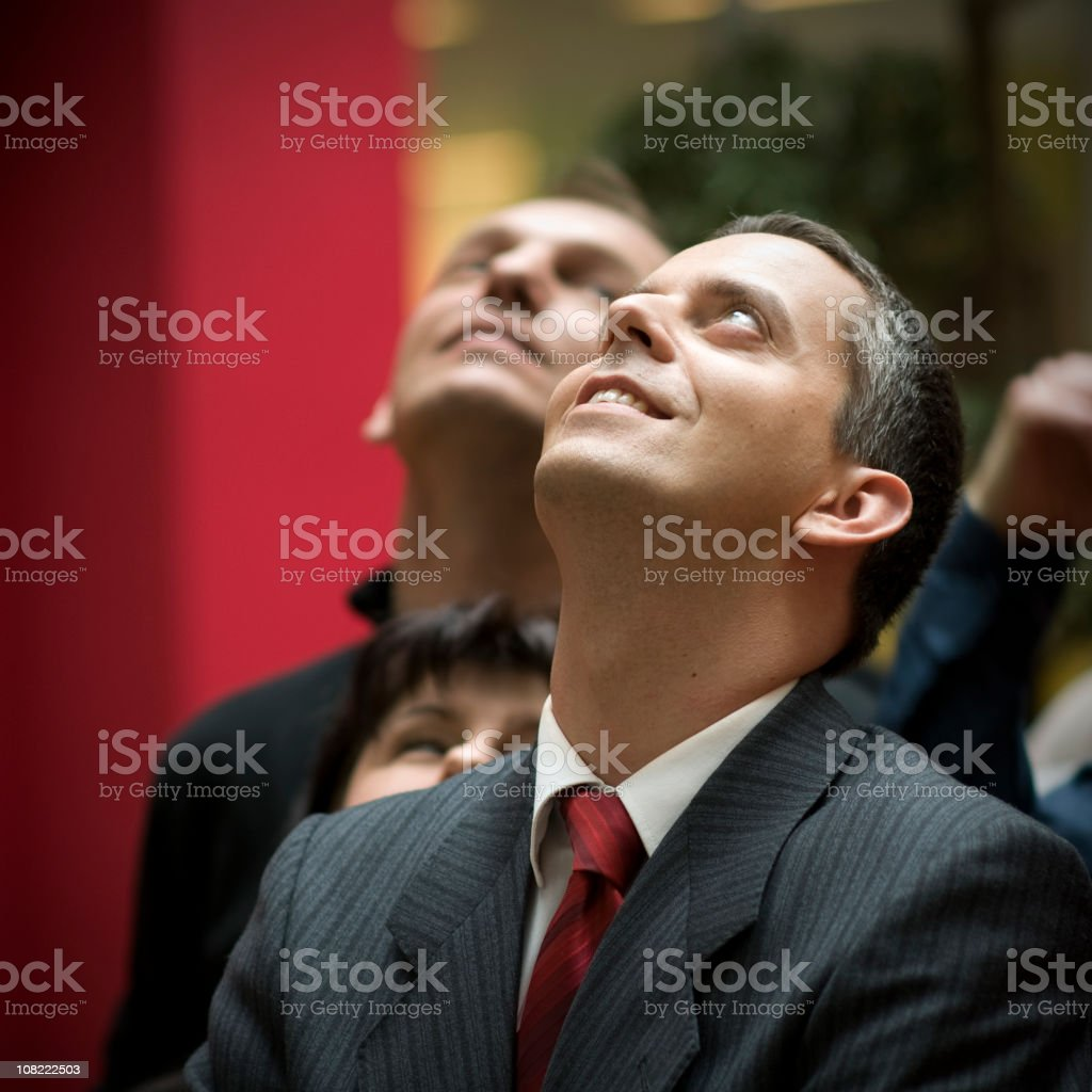 Businessman Standing in Group and Looking Up royalty-free stock photo
