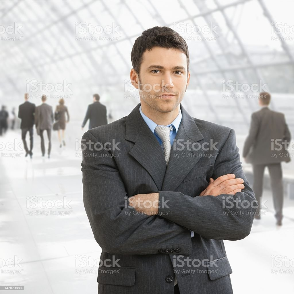 Businessman standing in office lobby royalty-free stock photo