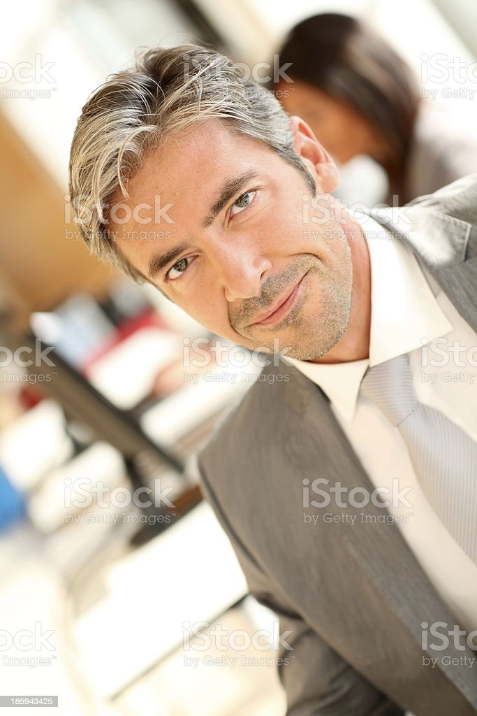 Businessman standing in office royalty-free stock photo