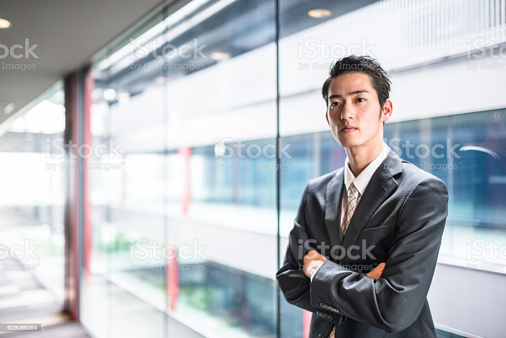 businessman standing in the office corridor stock photo