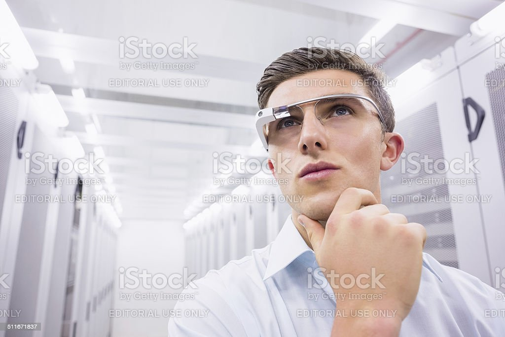 Businessman standing in the server room stock photo