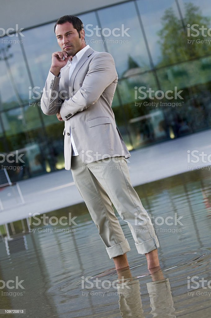 businessman standing in water royalty-free stock photo