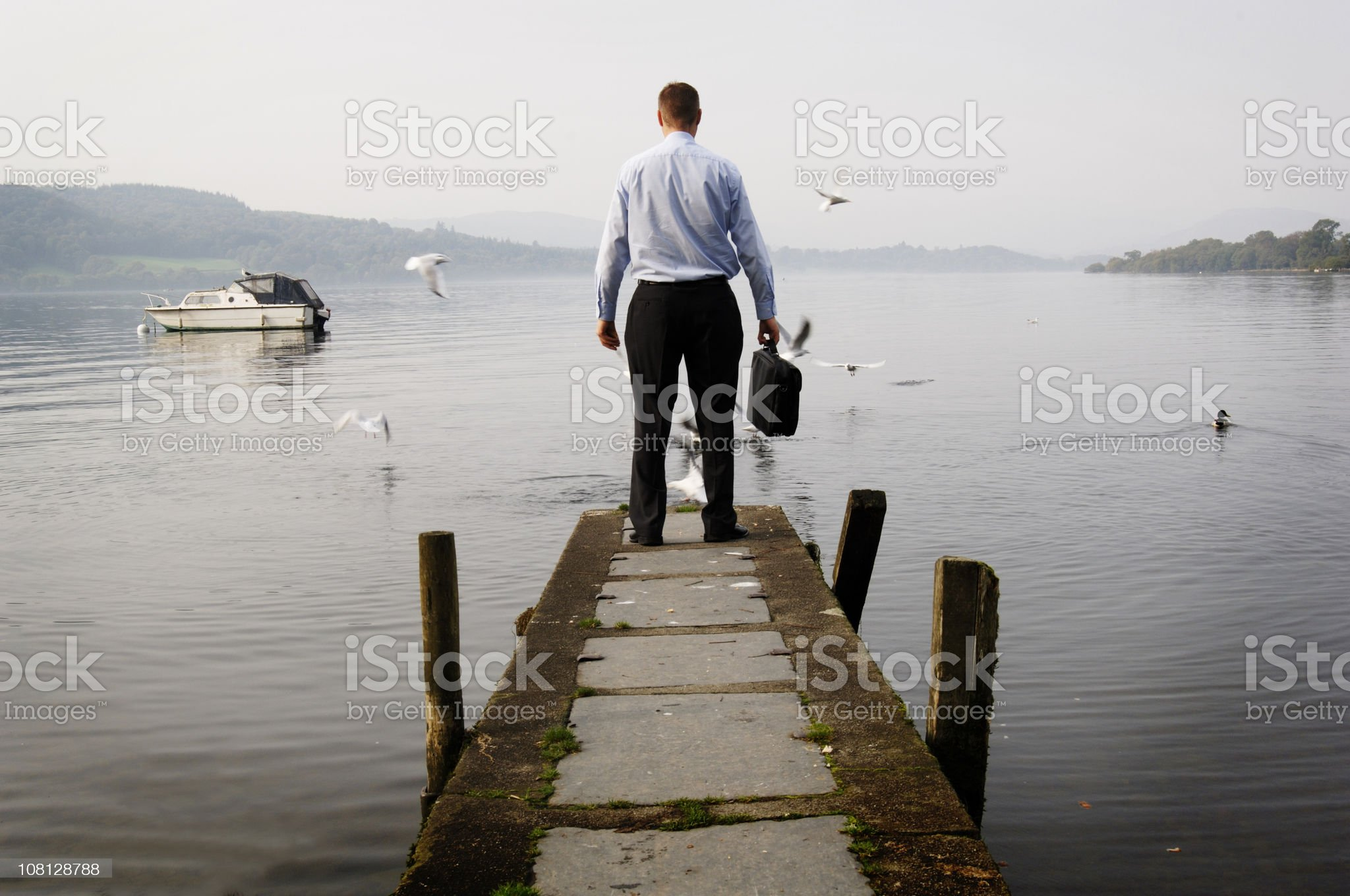 Businessman Standing Lake Jetty royalty-free stock photo