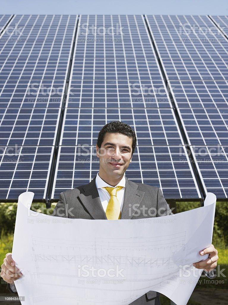 businessman standing near solar panels royalty-free stock photo