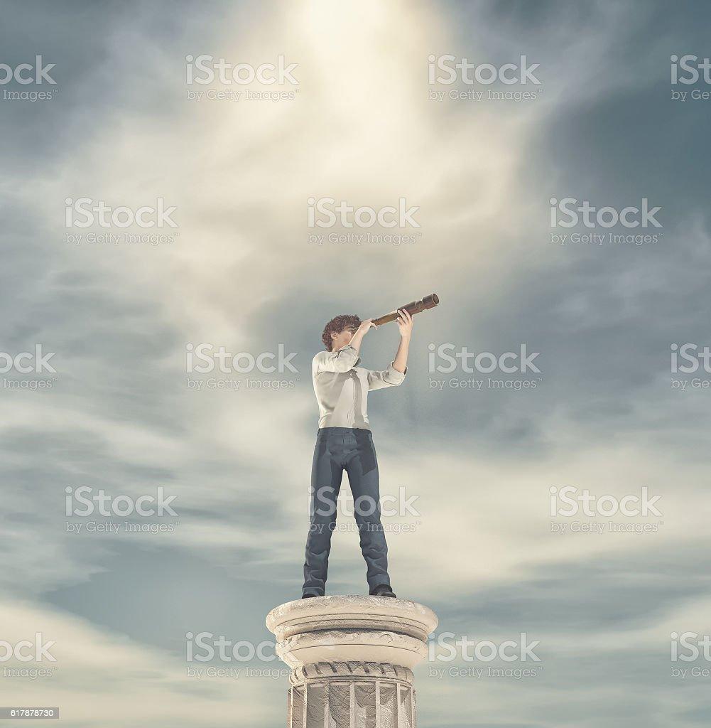 Businessman standing on a column stock photo