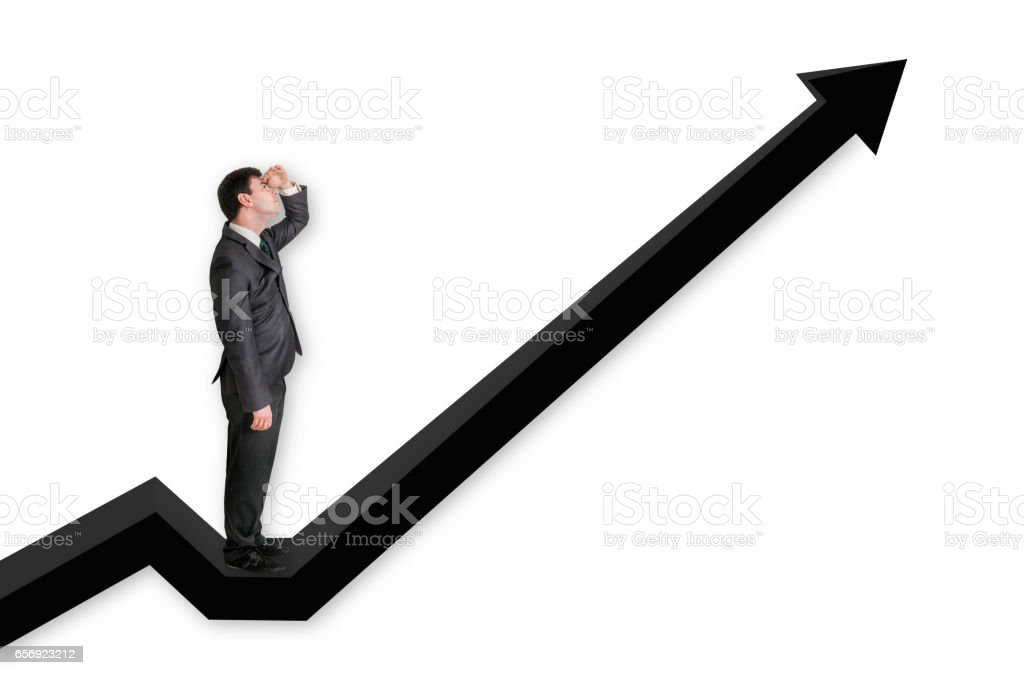 Businessman standing on a graph and looking up on the results stock photo