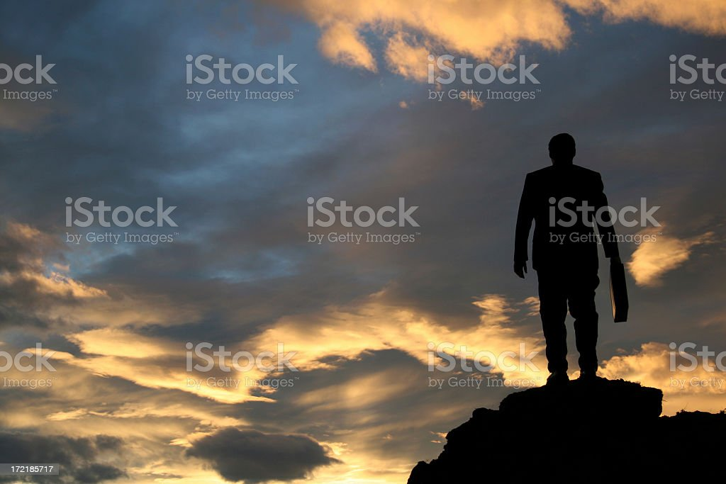 Businessman Standing on a Mountain Silhouette royalty-free stock photo