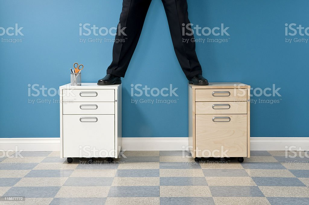Businessman Standing On File Cabinets. royalty-free stock photo
