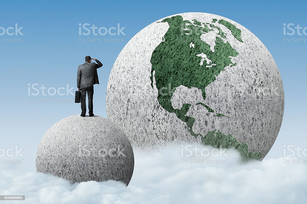 Businessman Standing On Outside Looking In stock photo