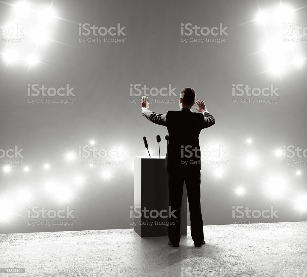 businessman standing on podium stock photo