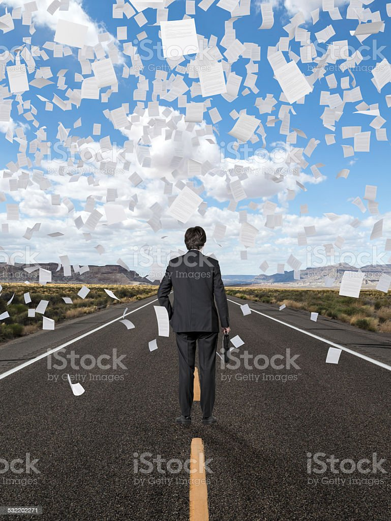businessman standing on road stock photo